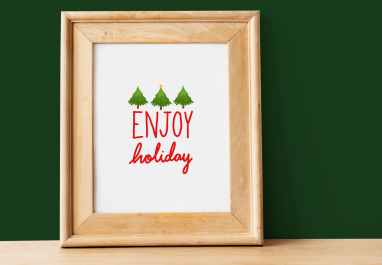 framed signage of enjoy holiday text
